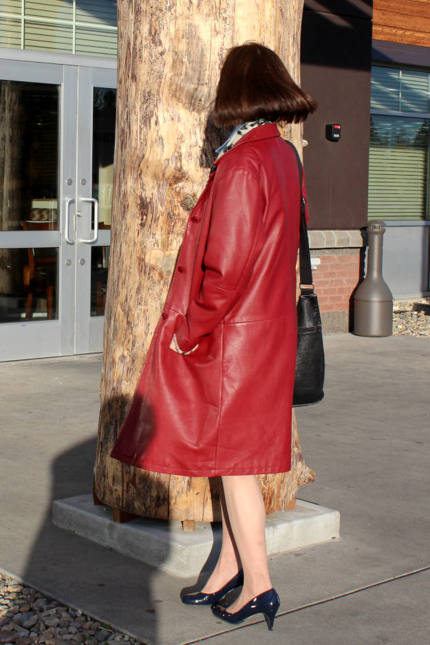 #fashionover50 mature woman in boxy leather coat with patent leather pumps