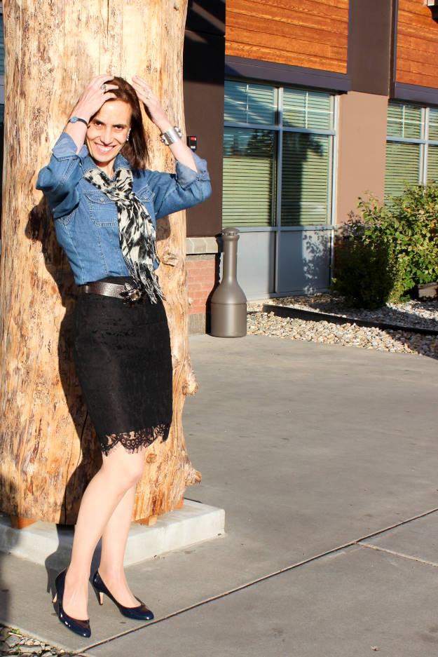 style book author in black lace pencil skirt, denim shirt and leopard print scarf with ptent leather pumps
