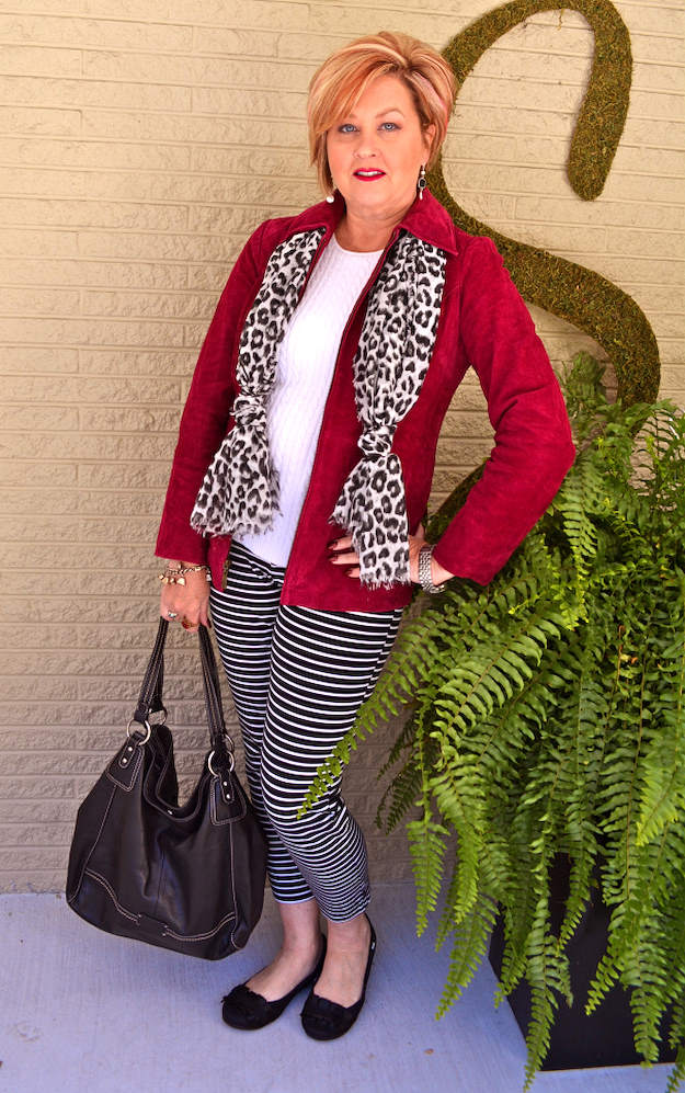 Co-host Tania mixing stripes and leopard print in one outfit