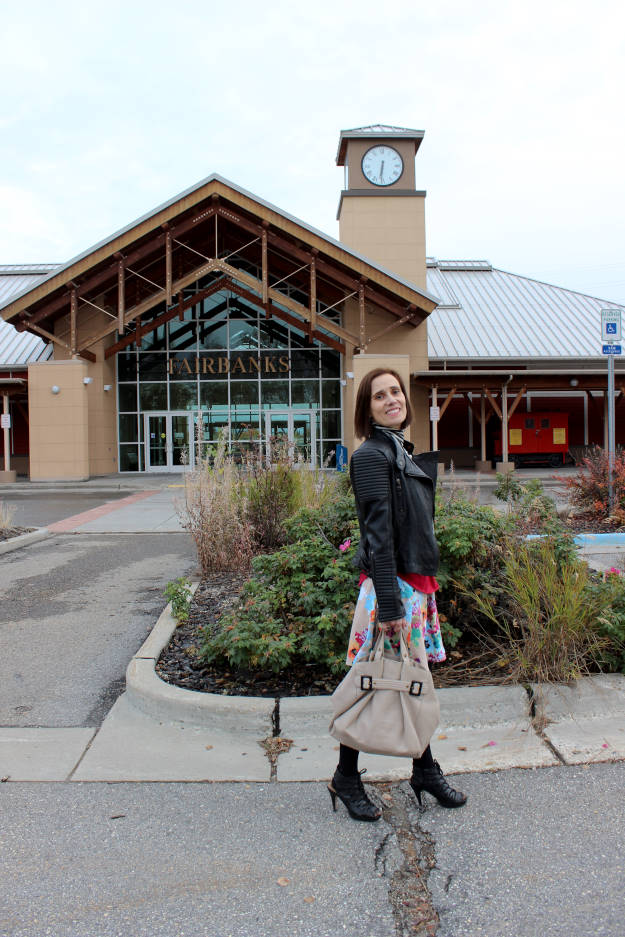 #fashionover50 mature woman in fall outfit in front of the Fairbanks railway station