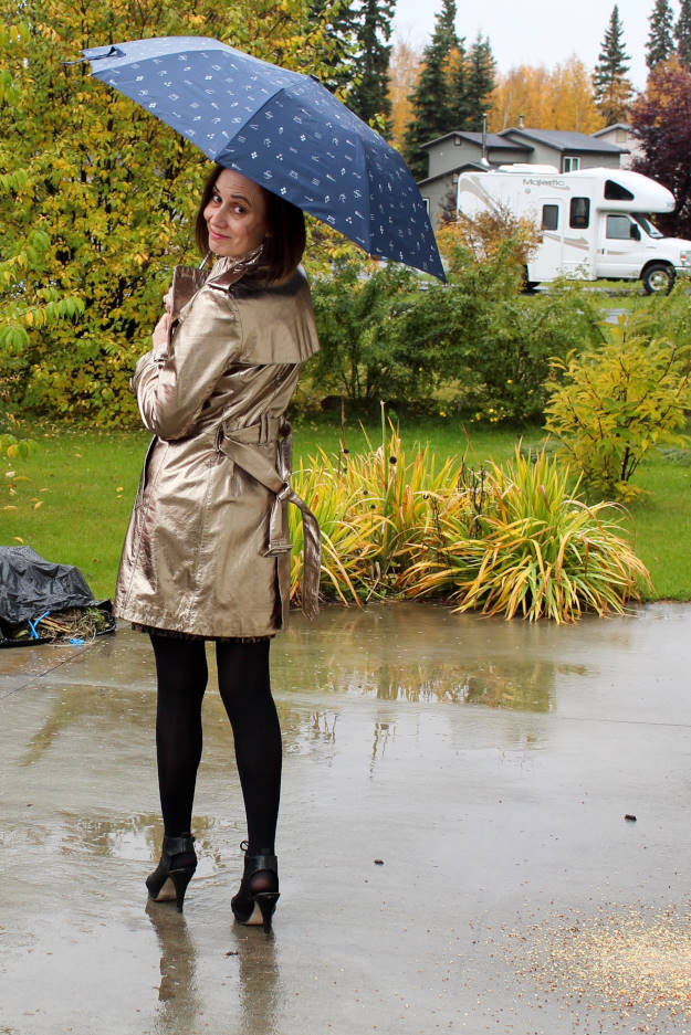 Woman in a golden trench coat on a rainy day