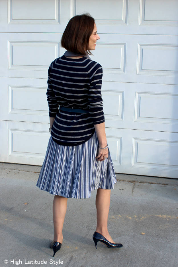 #fashionover50 mature woman in light makeup and blue and white posh casual work outfit