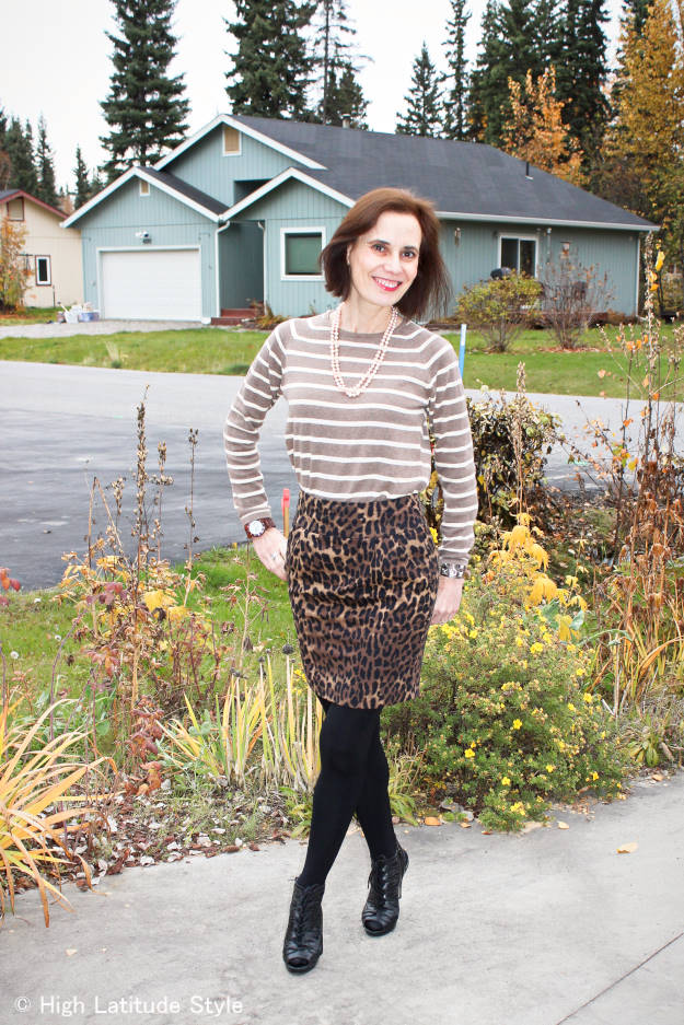#fashionover40 Nicole of High Latitude Style in leoprad print skirt with striped sweater and lace-up sandals