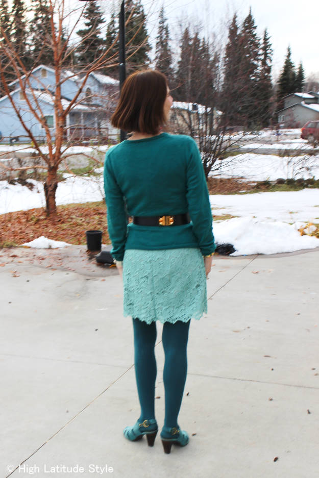 fashion blogger in monochromatic teal winter outfit