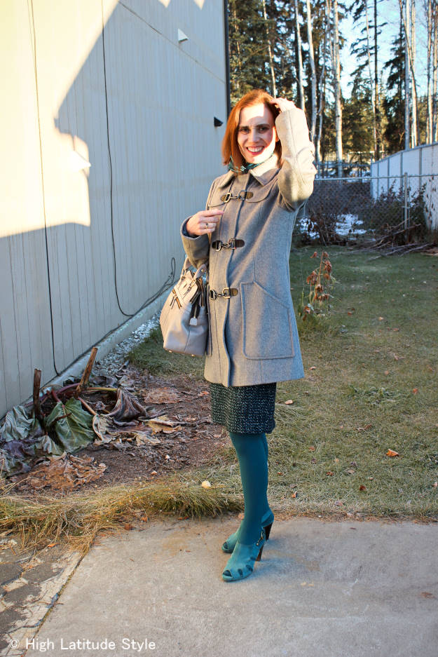 midlife fashion blogger in duffle coat, tweed skirt, fall sandals and turquoise tight