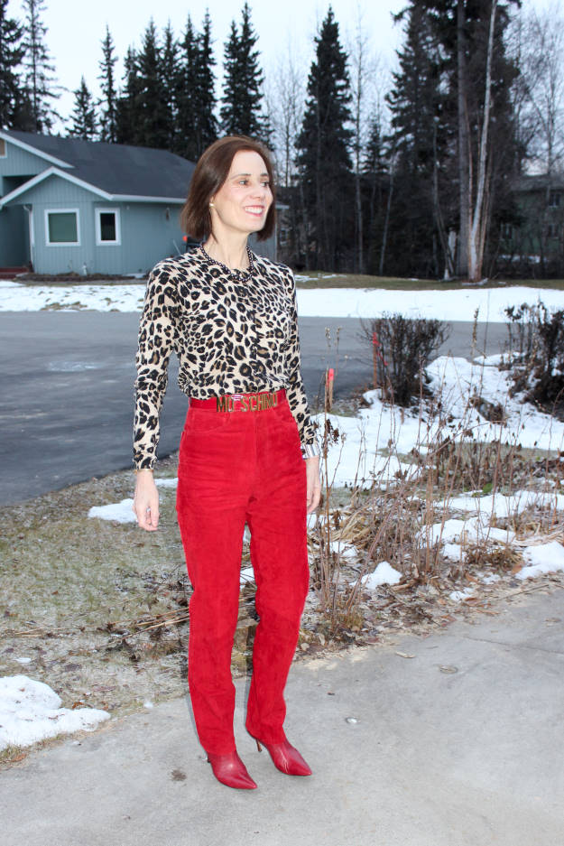 #fashionover50 woman in red suede pants and leopard print top