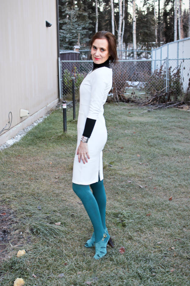#fashionover50 mature woman looking posh in a fitted dress, tights, and fall sandals