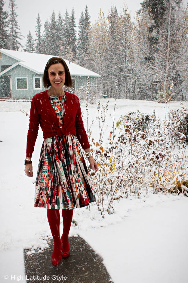 midlife woman in printed dress styled for a work holiday party