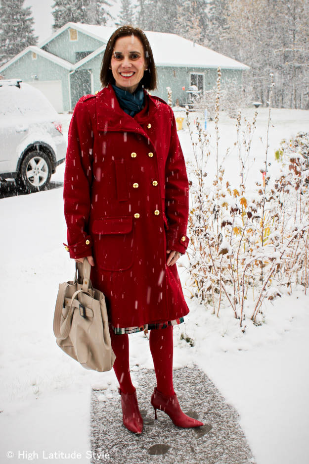 style blogger in fall outfit with red pea coat with matching tights and booties