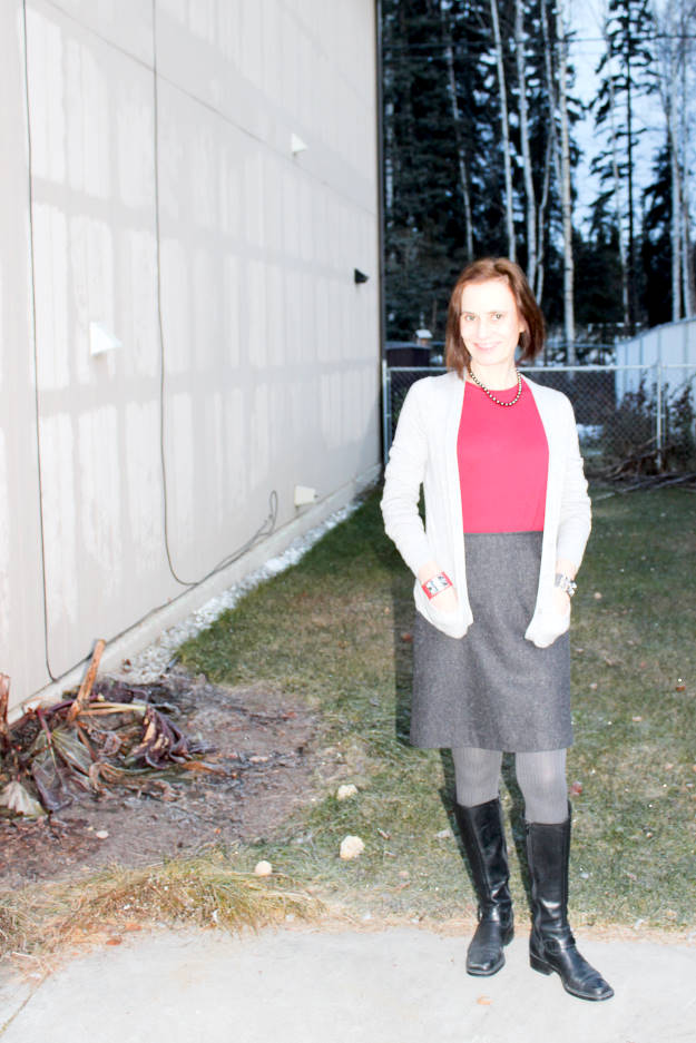 #fashionover40 style blogger Nicole in tweet skirt, sweater cardigan and riding boots