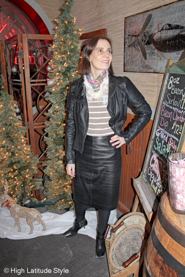 style book author wearing a faux skirt suit in black