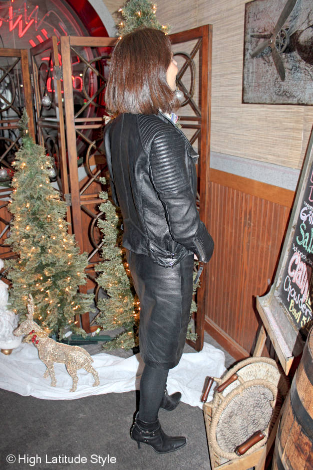 over 50 years old fashion blogger in a fake leather skirt suit