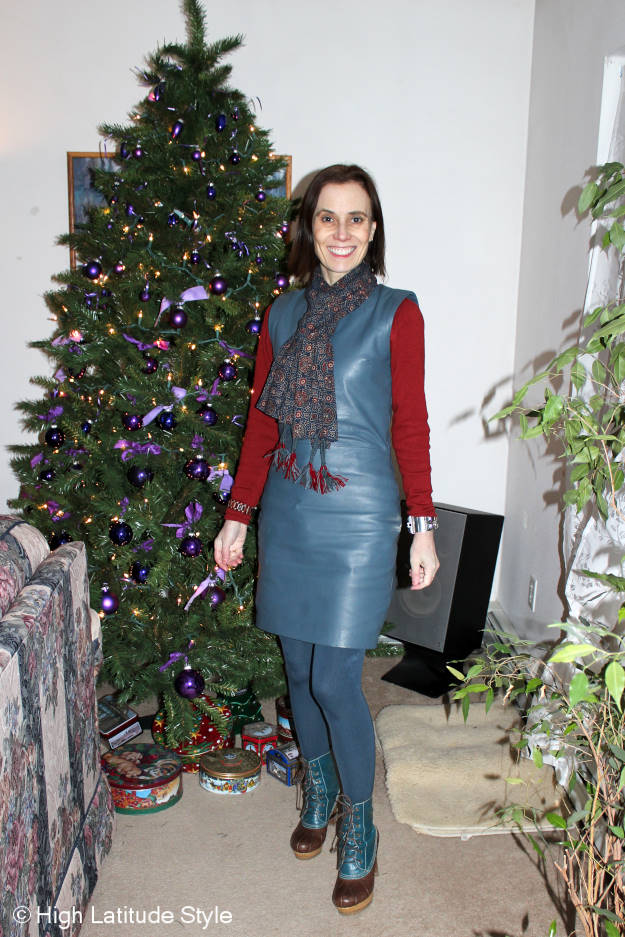 style blogger in leather sheath dress with an Indian block print scarf and statment dauck boots
