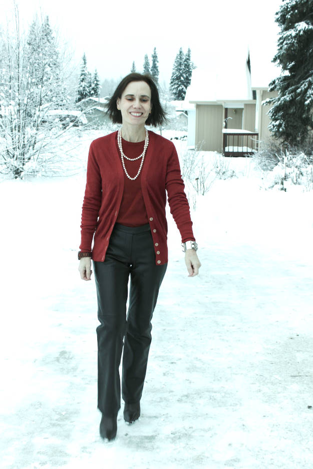 midlife woman in winter work outfit with leather pants