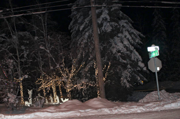 #travel crib display with twinkle lights in a Fairbanks front yard