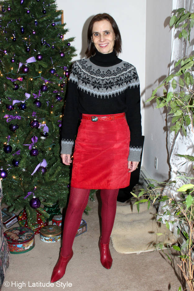 #Alaska #travel #holidays blooger posing ins a tweed skirt, Fair Isle sweater in the dark nights of Alaska's winter