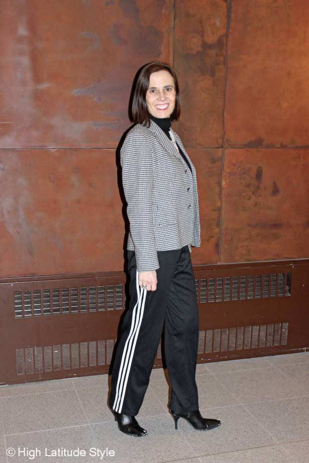 style blogger in an unmatched suit of Adidas track pants and classic houndstooth blazer