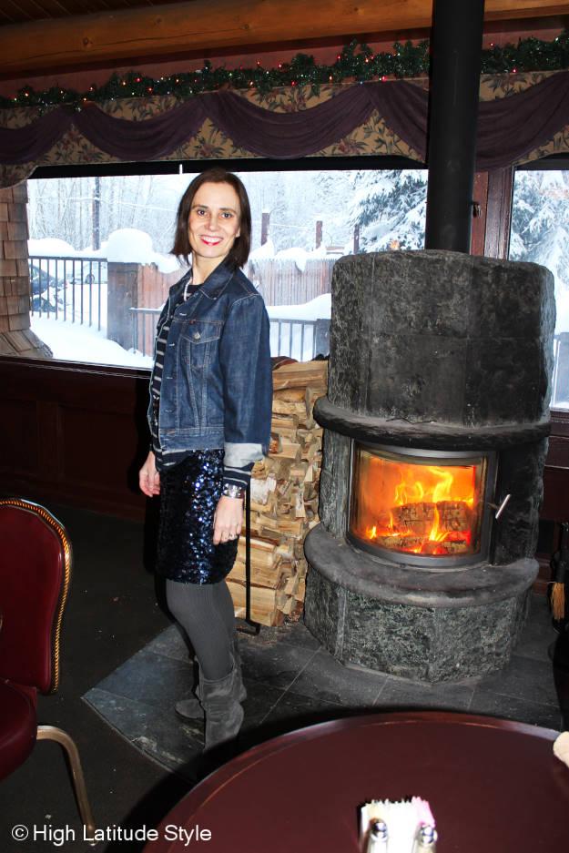 #styleover40 women in sequin skirt and denim jacket