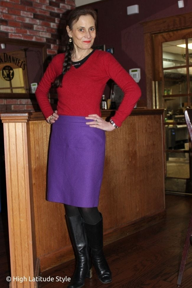 separates look with red sweater, purple skirt, black layering top, tights and boots