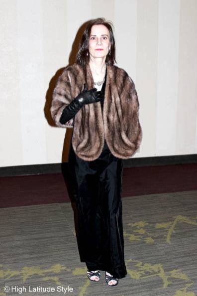 fashion blogger over 40 in black velvet ball attire for a winter ball