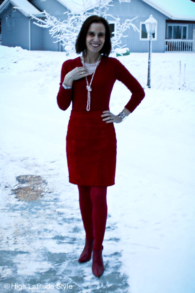 #fashionover40 woman in suede red skirt with lace under sweater