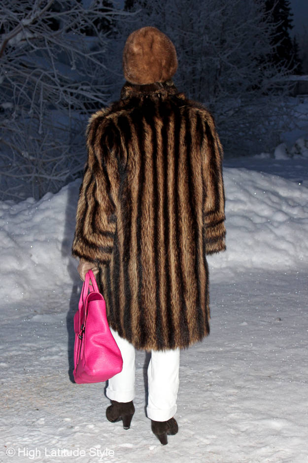 winter coat styled over white pants and shearling footwear