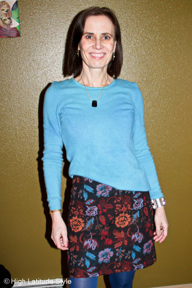 #fashionover40 midlife woman in floral sheath an aqua sweater