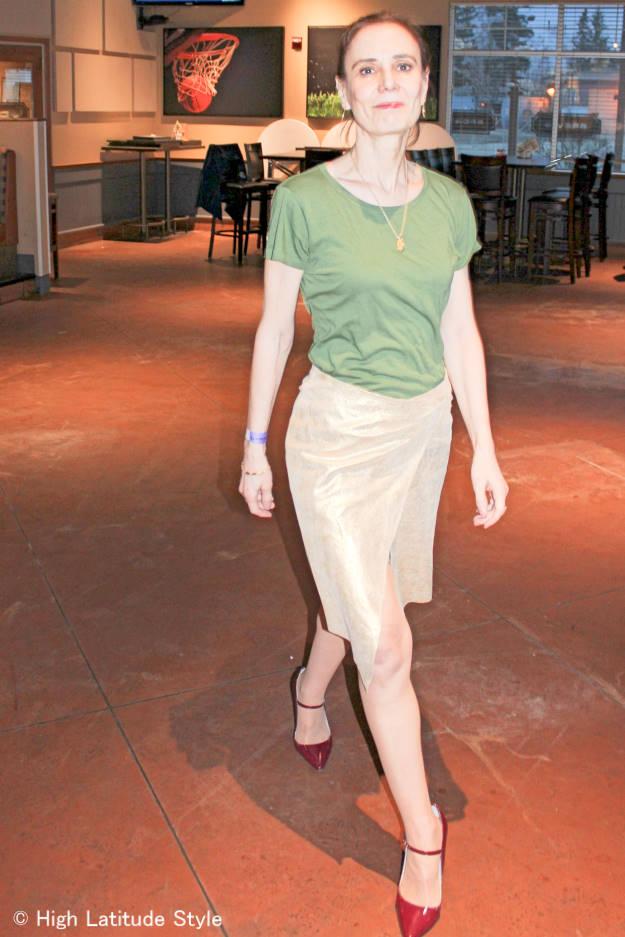 fashionover40 woman wearing a golden asymmetric skirt