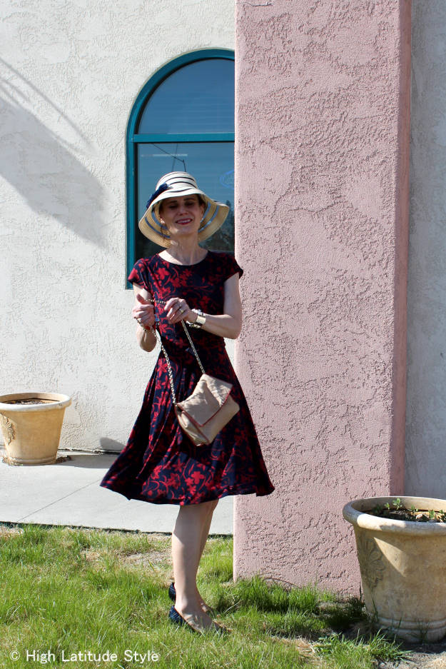 over 50 years old fashion blogger in a dress styled with sunhat for the weekend