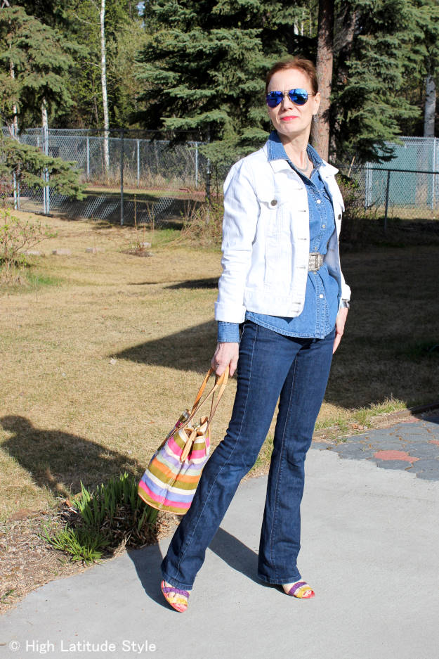 mature fashion blogger dressed in a Canadian tuxedo for a nice grill party outfit