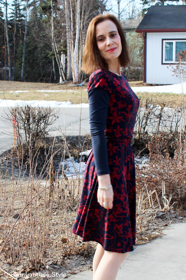 fashion blogger over 50 in a layered work outfit with summer dress for a chilly spring day