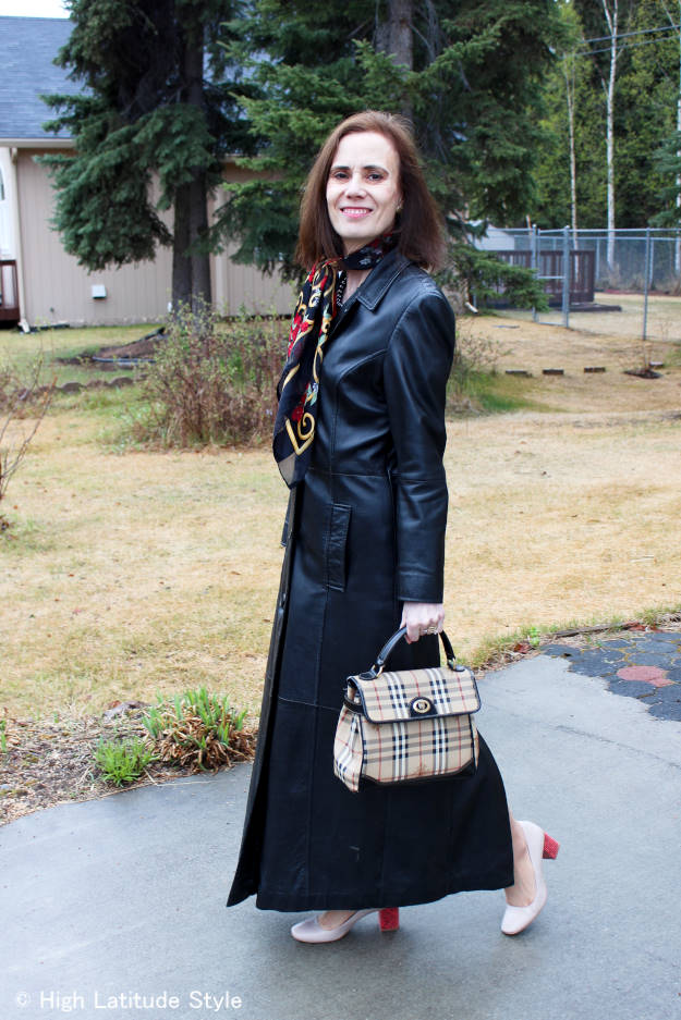 midlife woman in long leather coat
