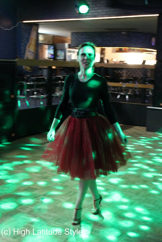 mature woman in a tutu skirt, top, dance shoes in a night bar