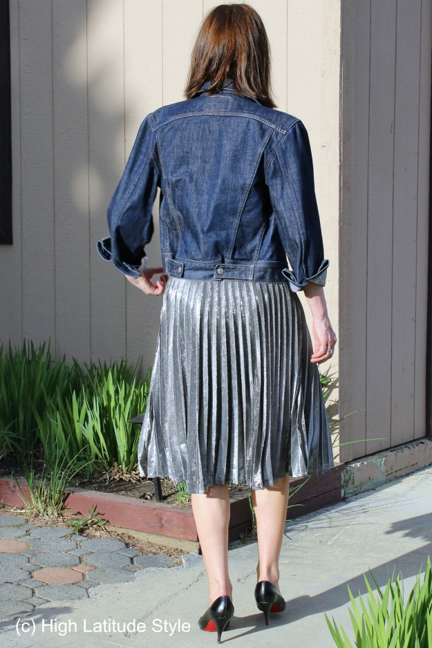 fashion over 40 woman in denim jacket and silver skirt