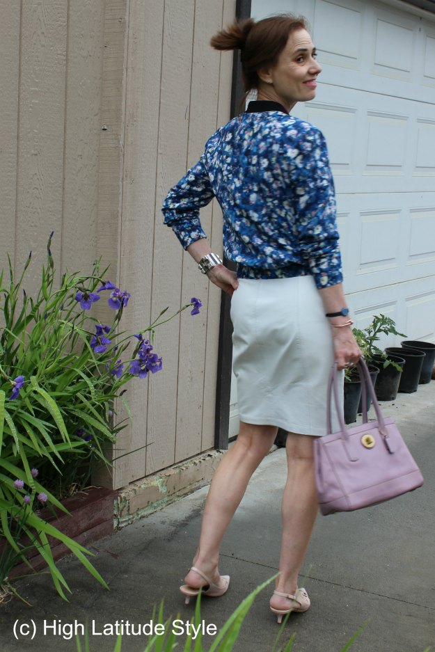 stylist in floral bomber with white leather skirt