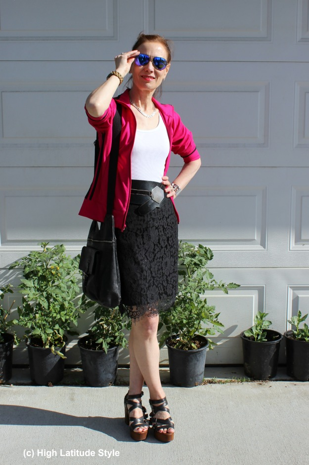 older woman wearing a lace skirt with a sport jacket