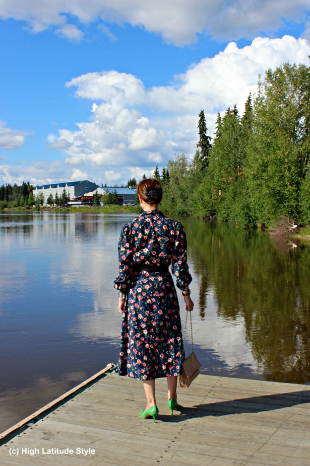 mature woman in shirt dress at the river