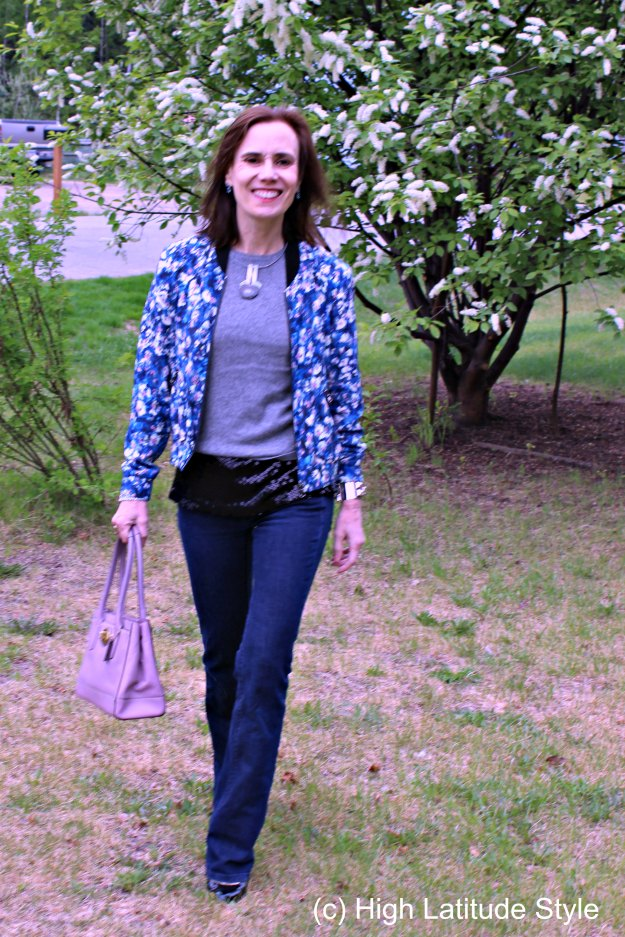 #maturefashion cruise outfit suggestion with floral bomber and flared jeans