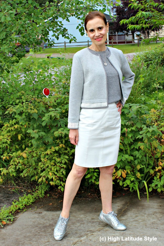 over 50 years old fashion blogger in skirt with sneakers outfit in the Arctic