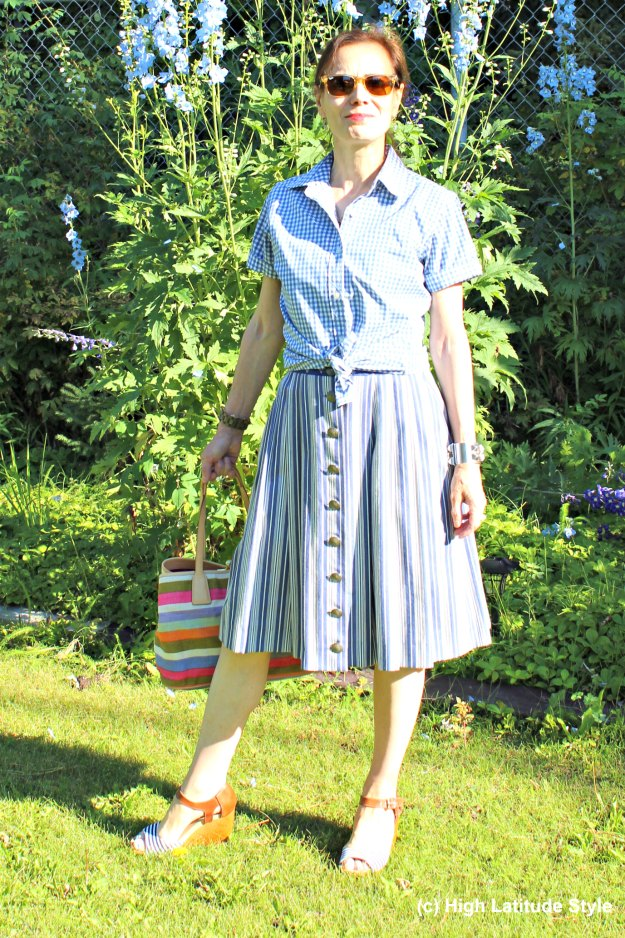 mature stylist in playful casual striped skirt and gingham shirt