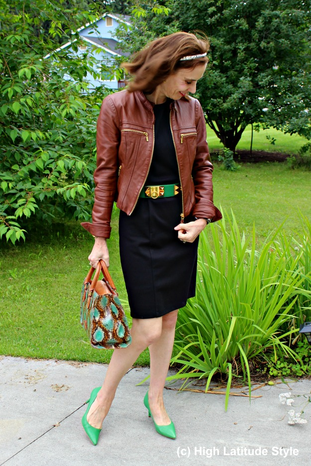 #styleover50 woman wearing black, brown and green together