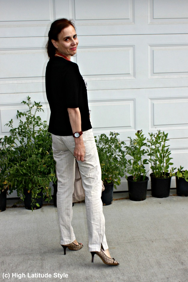 midlife woman wearing linen pants and a cardigan for the office