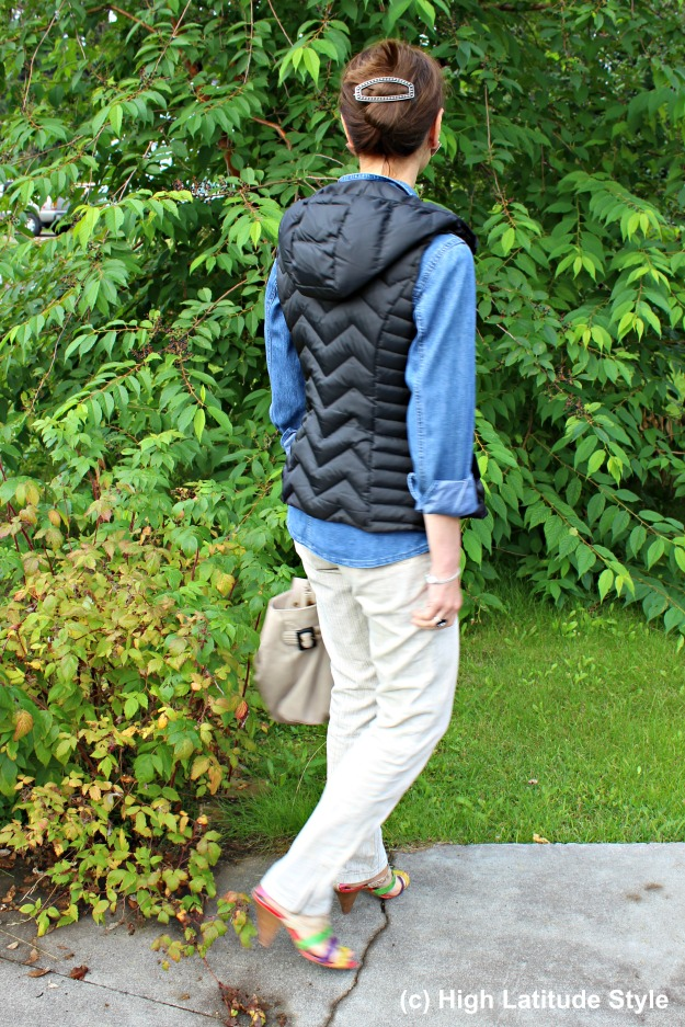 Mature Alaskan woman with hoodie vest and chinos