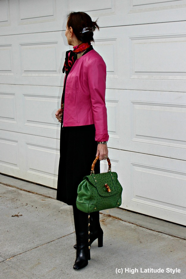 #fashionover40 woman in LBD, statement motorcycle coat with Gucci bag