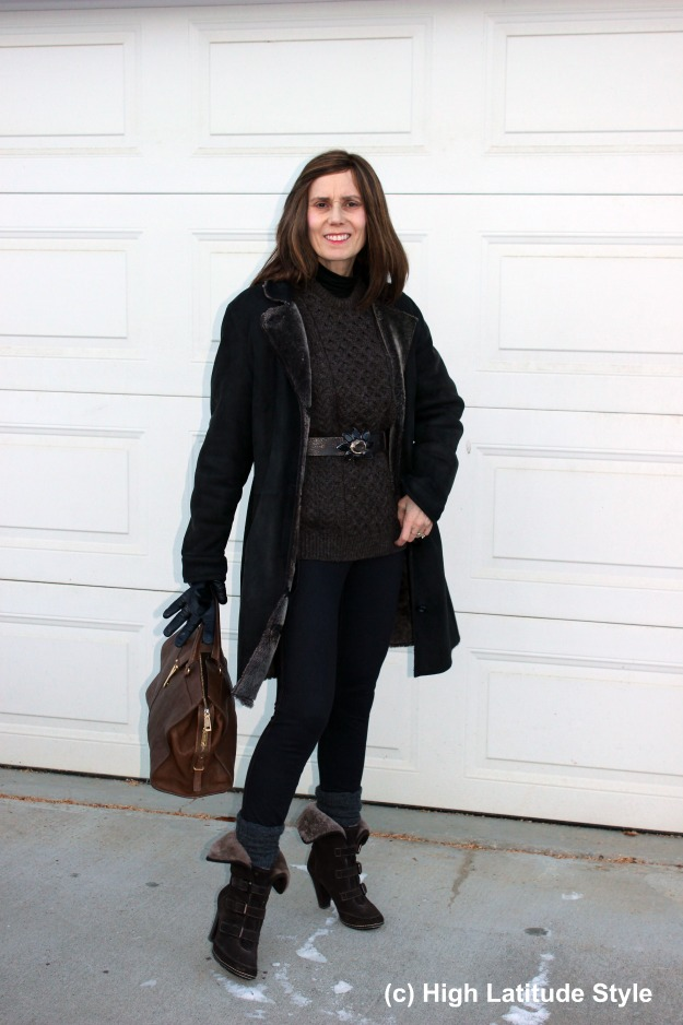 midlife fashion blogger in denim leggings, shearling and cable-knit sweater casual winter look