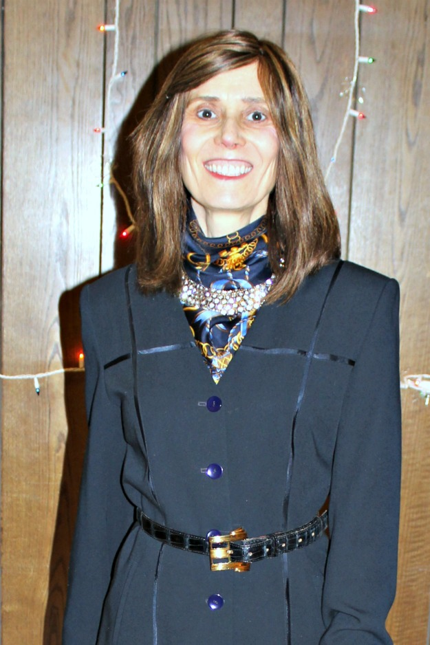 #styleover40 women wearing a statement necklace for a holiday party look