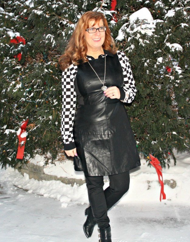 midlife woman in black and white outfit with leather dress
