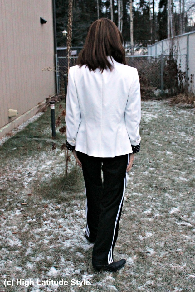 midlife woman in fake black and white suit