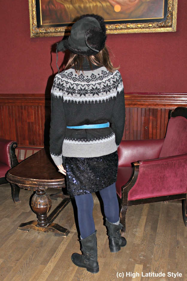 mature style blogger over 40 woman in posh eclectic sequin skirt with Irish sweater winter outfit