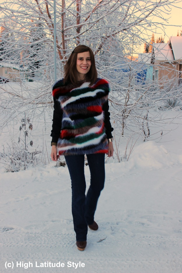 woman in multiple color faux fur sweater and flared jeans